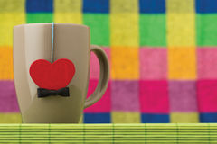 Cup and heart with a bow Royalty Free Stock Photography