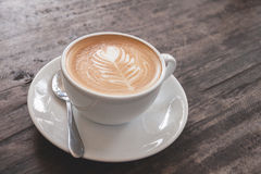 Cup of heart latte art. On wood table Royalty Free Stock Photo