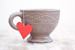 Cup with heart shaped tea bag Royalty Free Stock Photography