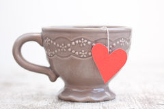 Cup with heart shaped tea bag Stock Images