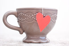 Cup with heart shaped tea bag Stock Image
