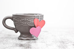 Cup with heart shaped tea bag Royalty Free Stock Photos