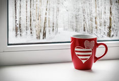 Cup with hearts Stock Images