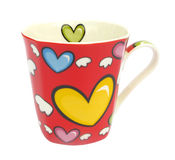 Cup with hearts that have wings Stock Photography