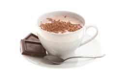 Cup heiße Schokolade mit einem Löffel Stockfotos