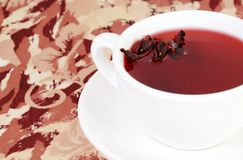 Cup of Herbal Red Tea with Petals Royalty Free Stock Photo