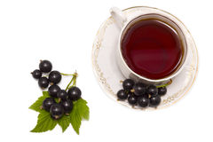 Cup of herbal tea and black curran Royalty Free Stock Images