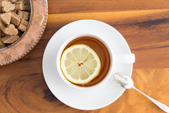 Cup of herbal tea with brown sugar Royalty Free Stock Image