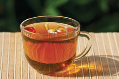 Cup of herbal tea and chamomile Stock Photos