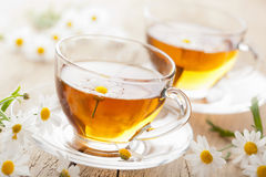 Cup of herbal tea with chamomile flower Royalty Free Stock Photography