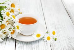 Cup of herbal tea with chamomile flowers Royalty Free Stock Photography