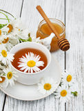 Cup of herbal tea with chamomile flowers Royalty Free Stock Images