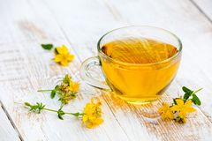 A cup of herbal tea. On the grunge wooden table royalty free stock photos