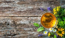 Cup of herbal tea. On wooden table royalty free stock images