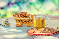 A cup of herbal tea. On a wooden table in the garden Stock Image