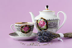 Cup of herbal tea decorated with fresh and dry lavender herbs. P. Orcelain cup of tea drink garnished with lavender and camomile flowers royalty free stock image