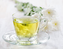 Cup of herbal tea and flowers Royalty Free Stock Photography
