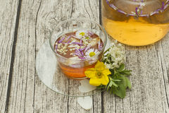 Cup of herbal tea with flowers Royalty Free Stock Photo