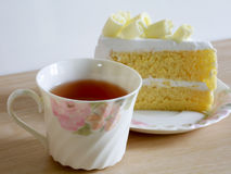 Cup of herbal tea and fresh cake. Homemade white chocolate cakes , selective focus Stock Photo
