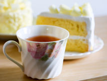 Cup of herbal tea and fresh cakes. Stock Photos