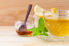 Cup of herbal tea with fresh green mint Royalty Free Stock Photo