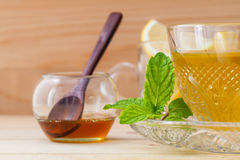 Cup of herbal tea with fresh green mint Royalty Free Stock Image