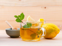 Cup of herbal tea with fresh green mint Stock Photos