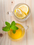 Cup of herbal tea with fresh green mint Stock Image