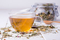 Cup of herbal tea with glass jar Stock Image