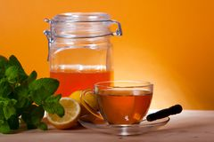 Cup of herbal tea and honey Royalty Free Stock Photography