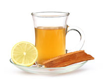 Cup of herbal tea with lemon and cinnamon bark Royalty Free Stock Image
