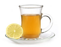 Cup of herbal tea with lemon Stock Photos