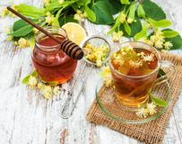 Cup of herbal tea with linden flowers stock images