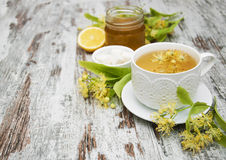 Cup of herbal tea with linden flowers Royalty Free Stock Photo