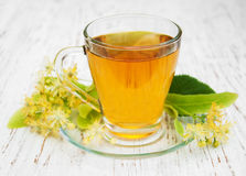 Cup of herbal tea with linden flowers Stock Photography