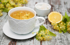 Cup of herbal tea with linden flowers Royalty Free Stock Images