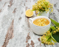 Cup of herbal tea with linden flowers Royalty Free Stock Photos