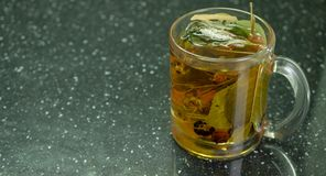 Cup of herbal tea royalty free stock photography