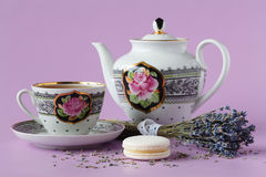 Cup of herbal tea with a porcelainkettle and a lavender bouquet. Cup of herbal tea with a porcelain kettle and a lavender bouquet stock image