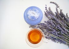 Cup of tea and lavender flowers on a white background Royalty Free Stock Photography