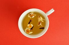 Herbal tea on red background stock image