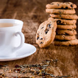 Cup of herbal tea and some fresh cookies Royalty Free Stock Image