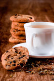 Cup of herbal tea and some fresh cookies. Closeup on wooden table Stock Photos