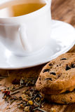 Cup of herbal tea and some fresh cookies. Closeup on wooden table Stock Image