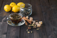 Cup of herbal tea, spices and lemon Royalty Free Stock Photography