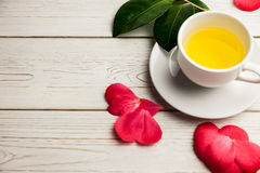 Cup of herbal tea on table Stock Photo