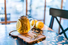 Cup of herbal tea with thyme and lemon served with board on the table. stock photos