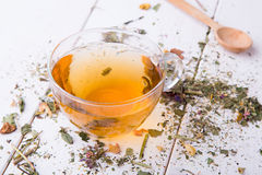 Cup of herbal tea on white wood table Royalty Free Stock Photography