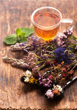 Cup of herbal tea with wild flowers and various herbs Stock Photo