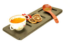 Cup of herbal tea on wooden tray isolated. Cup of herbal tea and fruit on wooden tray isolated on white background Stock Photography